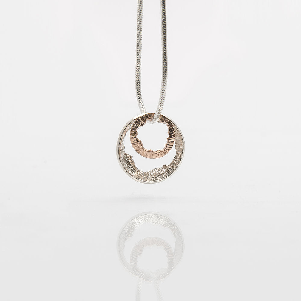 HALLMARKED SILVER & ROSE GOLD PENDANT. SHELL COLLECTION by Martina Hamilton