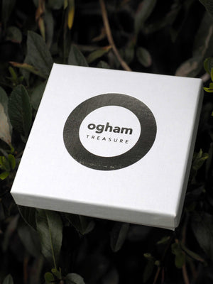 ogham treasure logo printed on a box