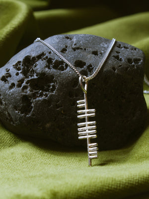 Music silver pendant on a stone