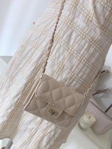 DE KOREAN GRID SLING BAG in beige (4408068046923)