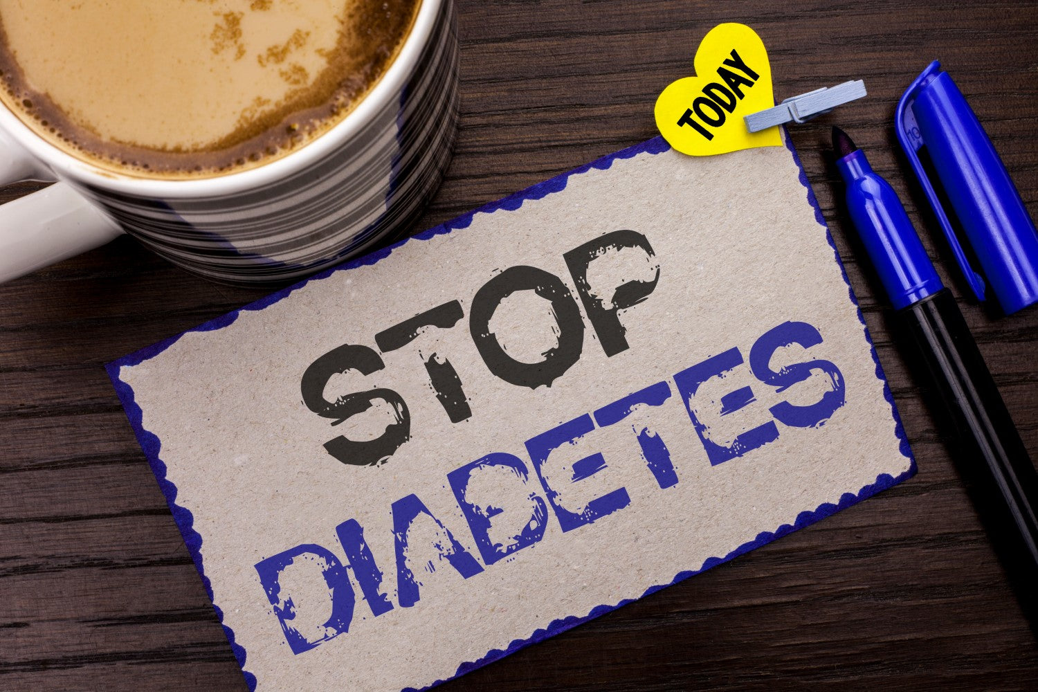 stop diabetes sign on board and coffee and pen