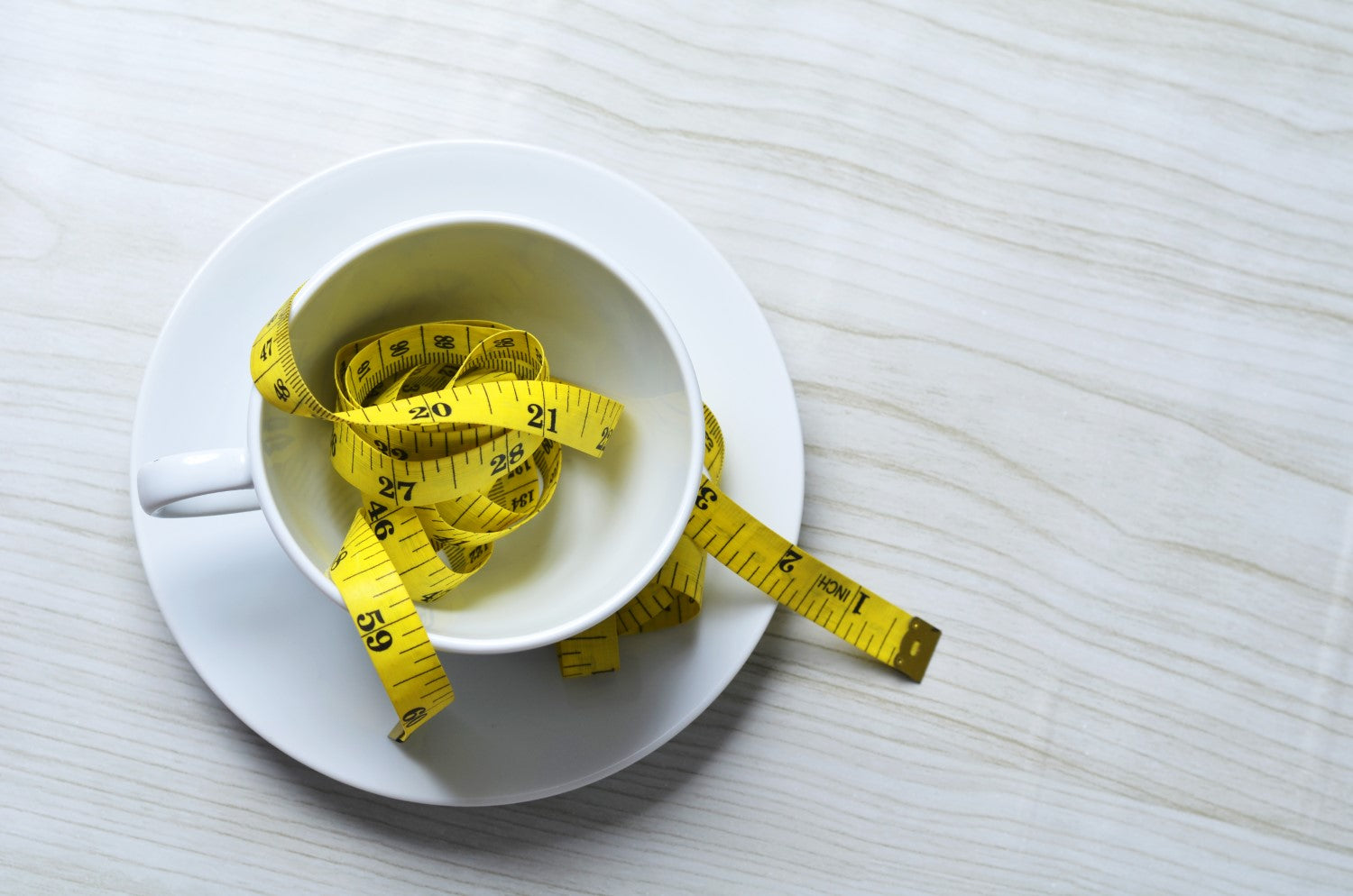 tape measure in a cup