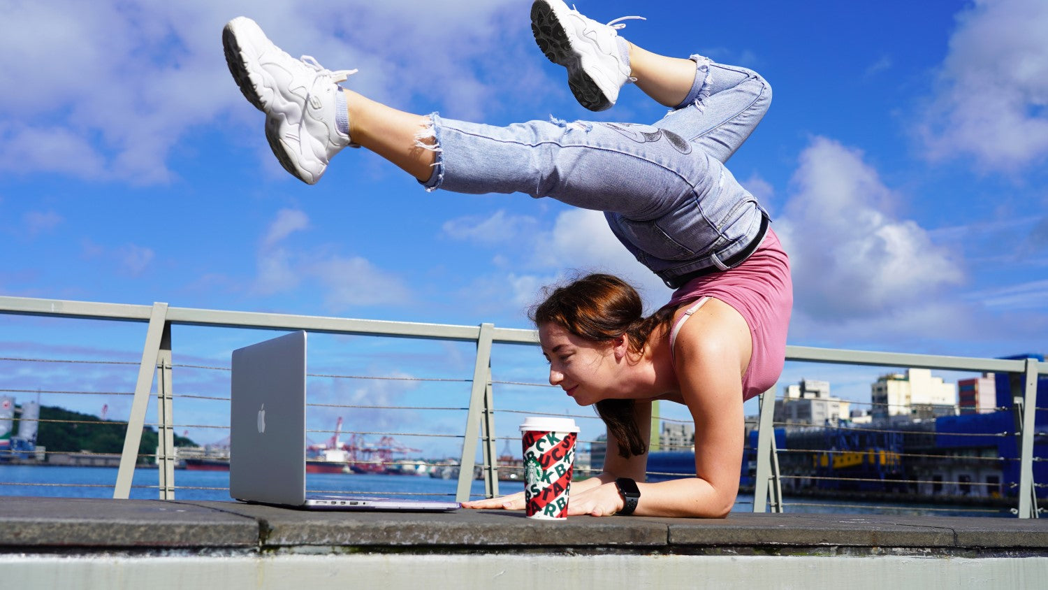 lady doing gymnastic with coffee in front