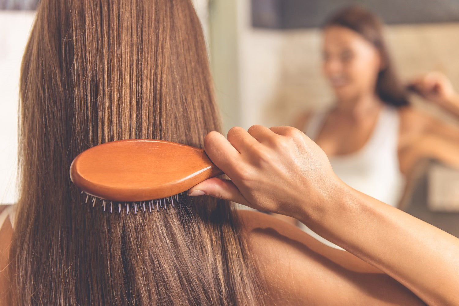 lady combing her healthy hair