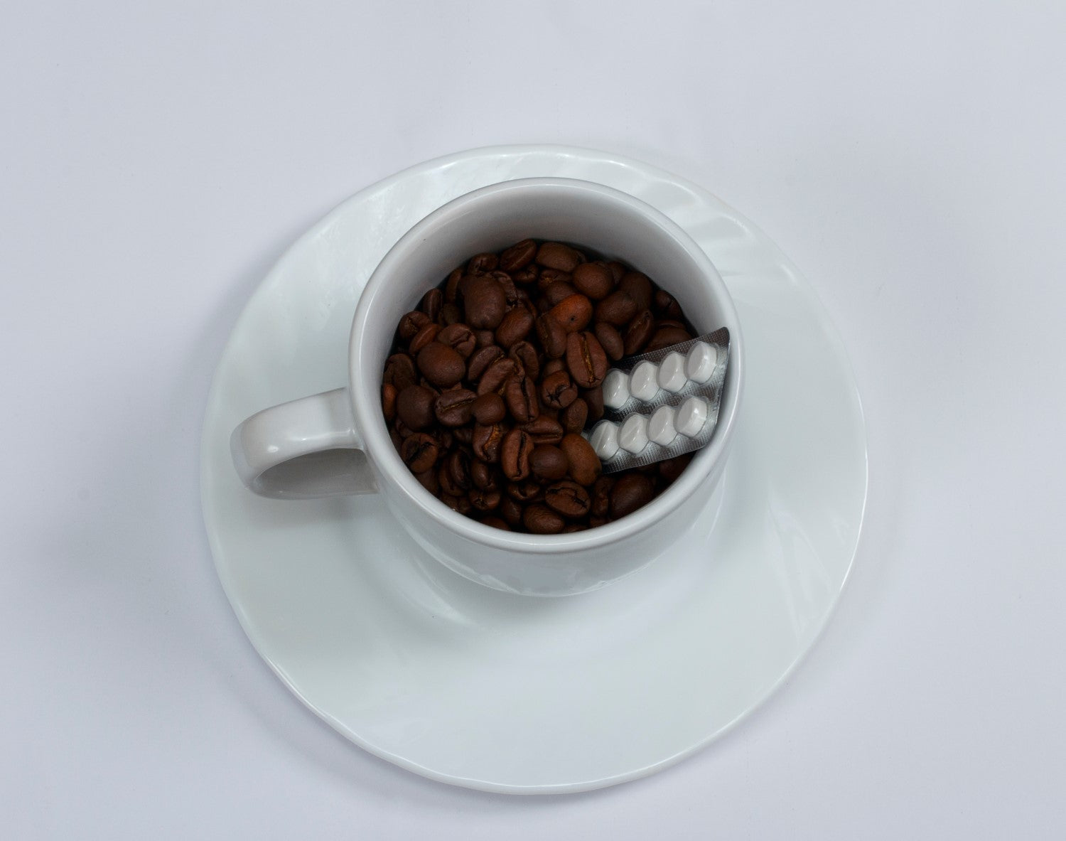 coffee beans with med inside the cup