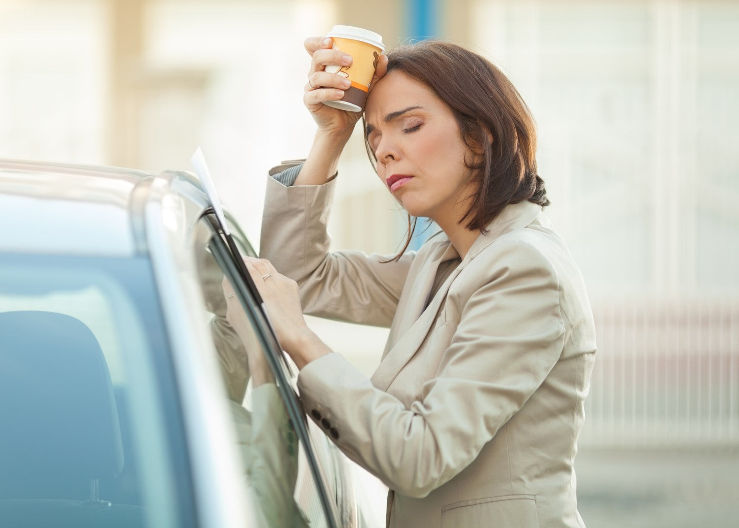 stressed woman holding a coffee