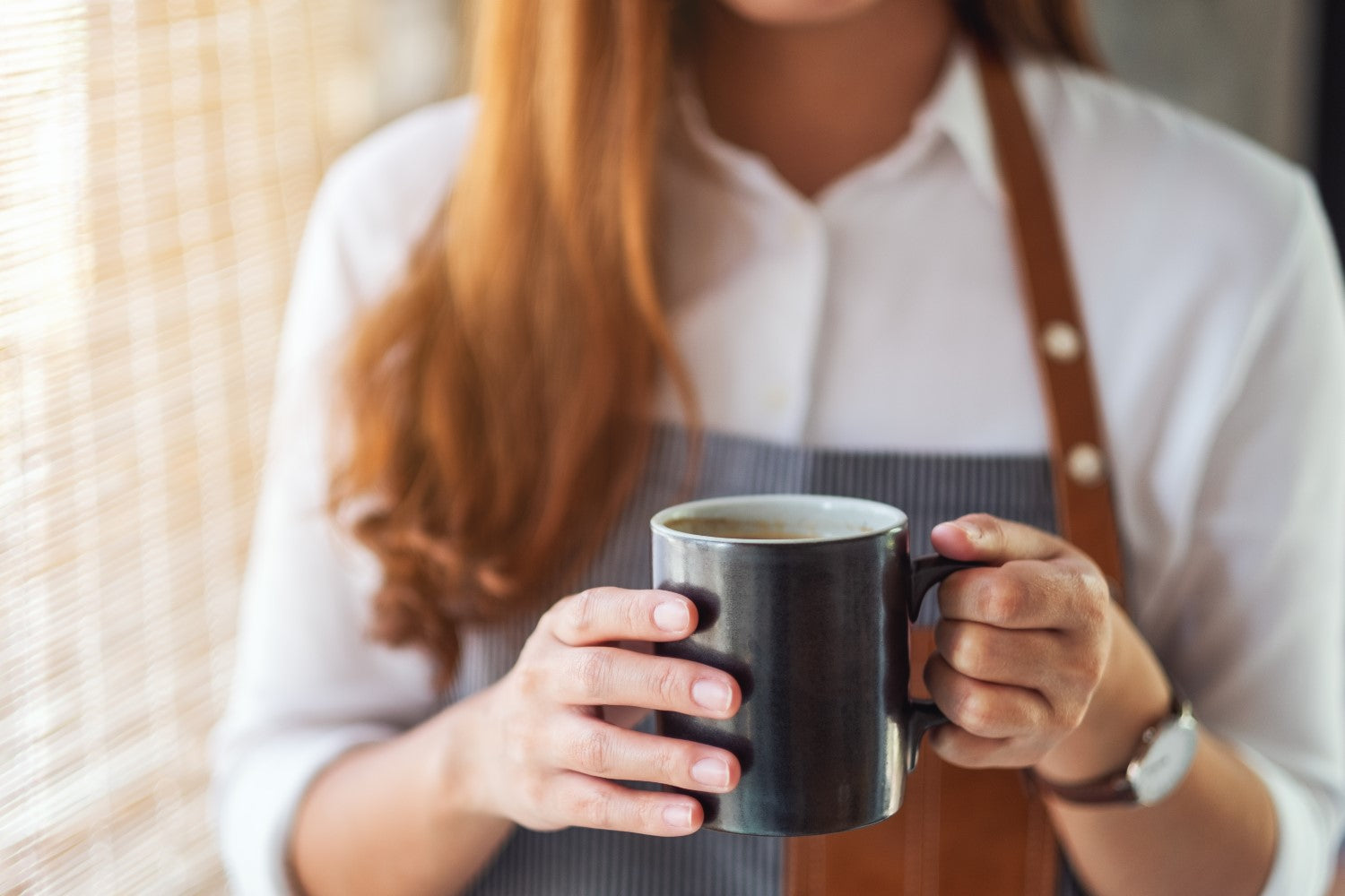 lady holding cup of coffee