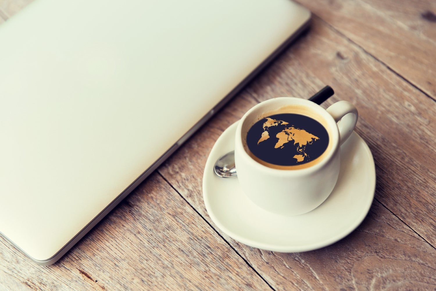 coffee with map on top and laptop