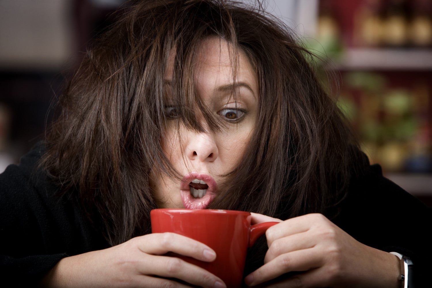 woman with addiction in a coffee
