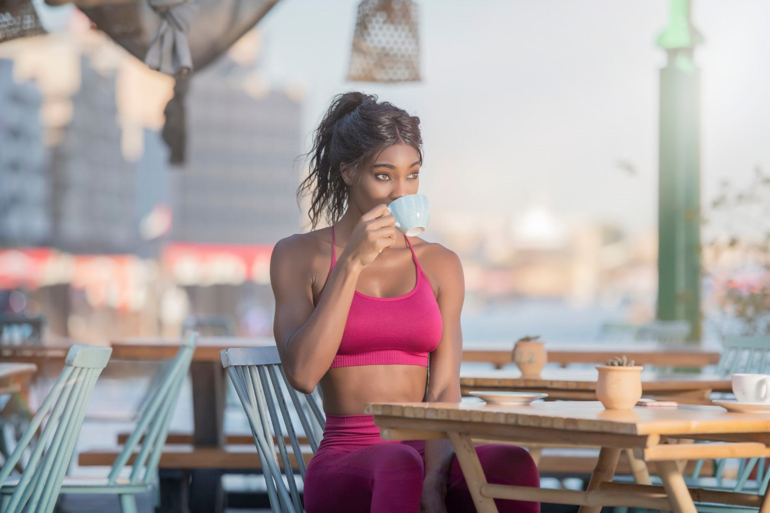 physically fit lady drinking coffee