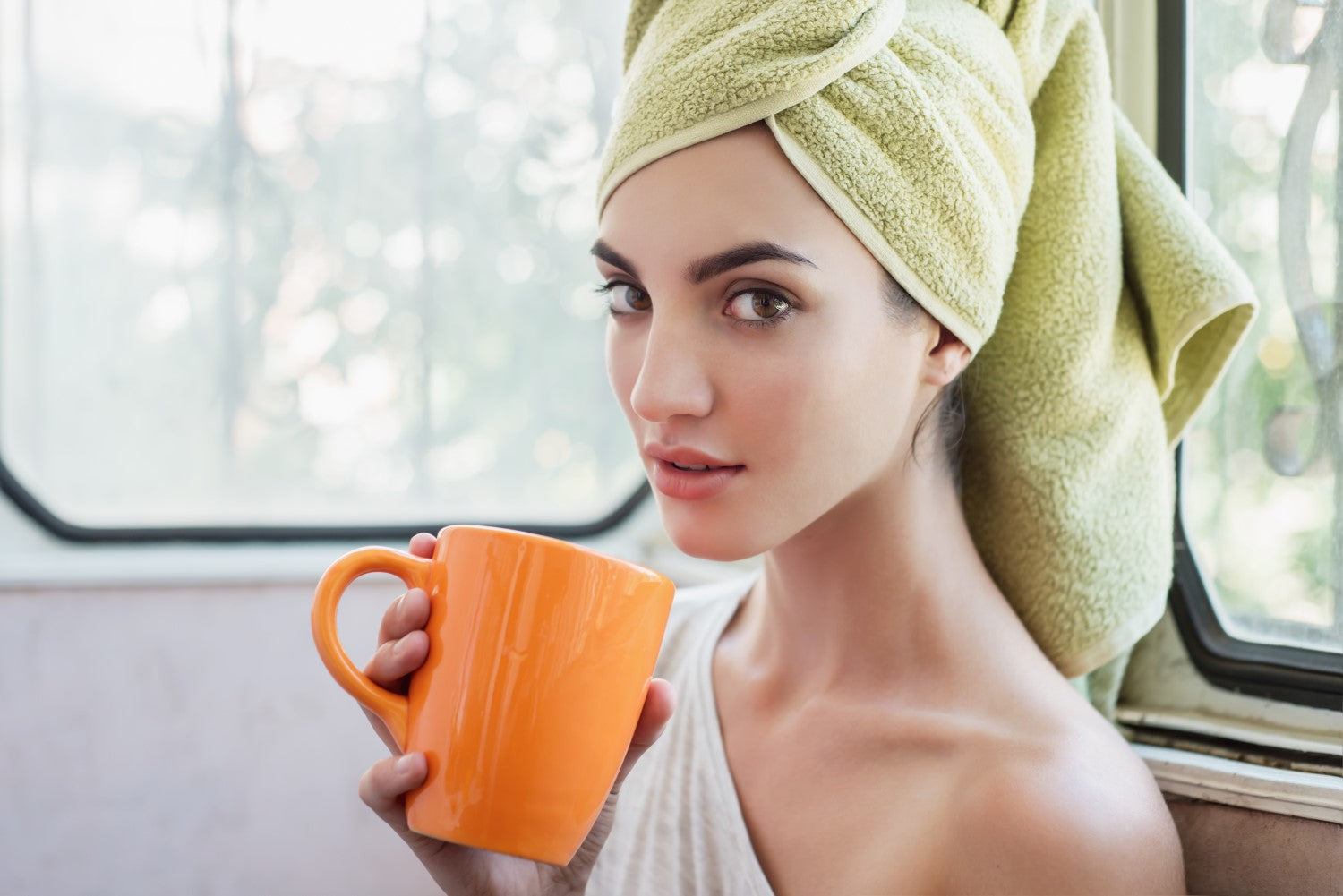 lady with good skin having coffee