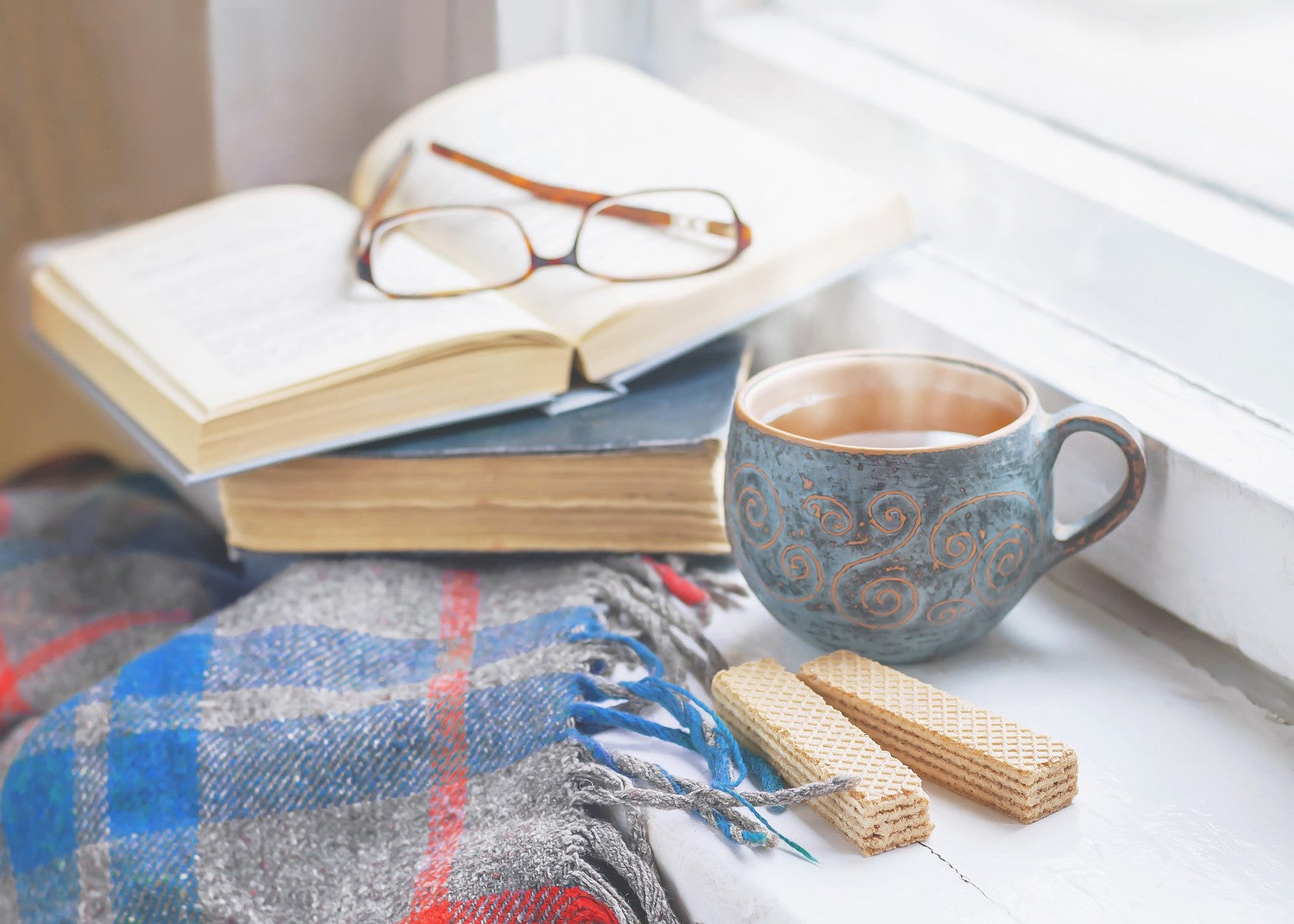 cup of coffee, books and eyeglass
