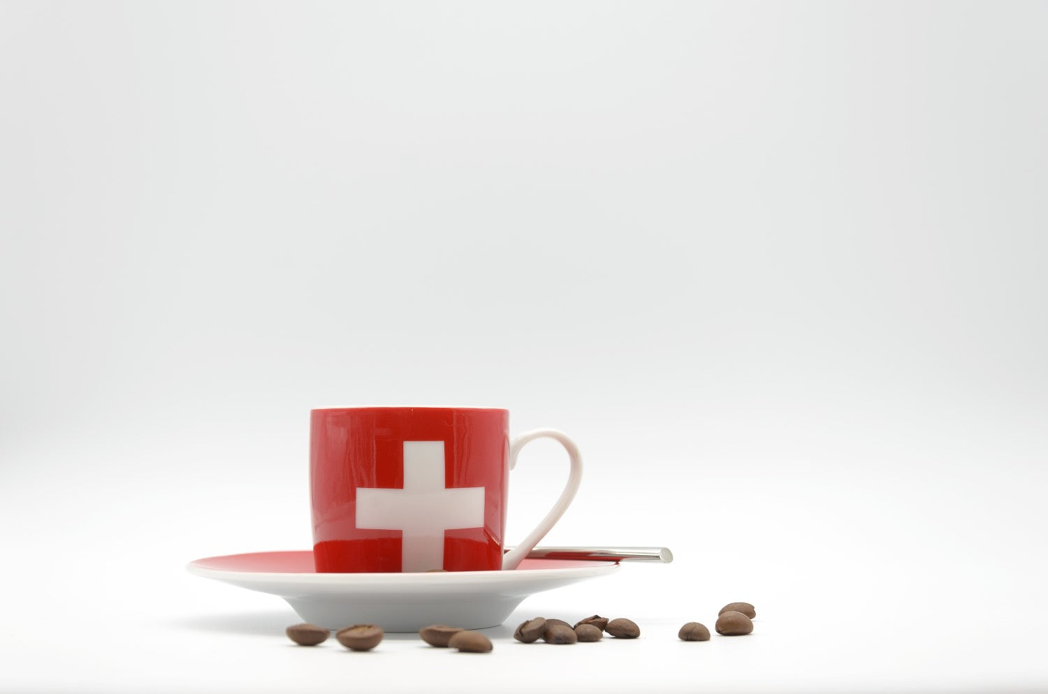 red cup with cross sign and coffee beans