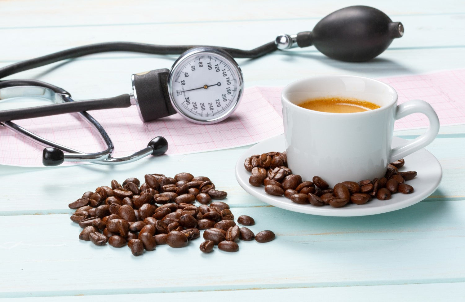 cup of coffee, beans and stethoscope