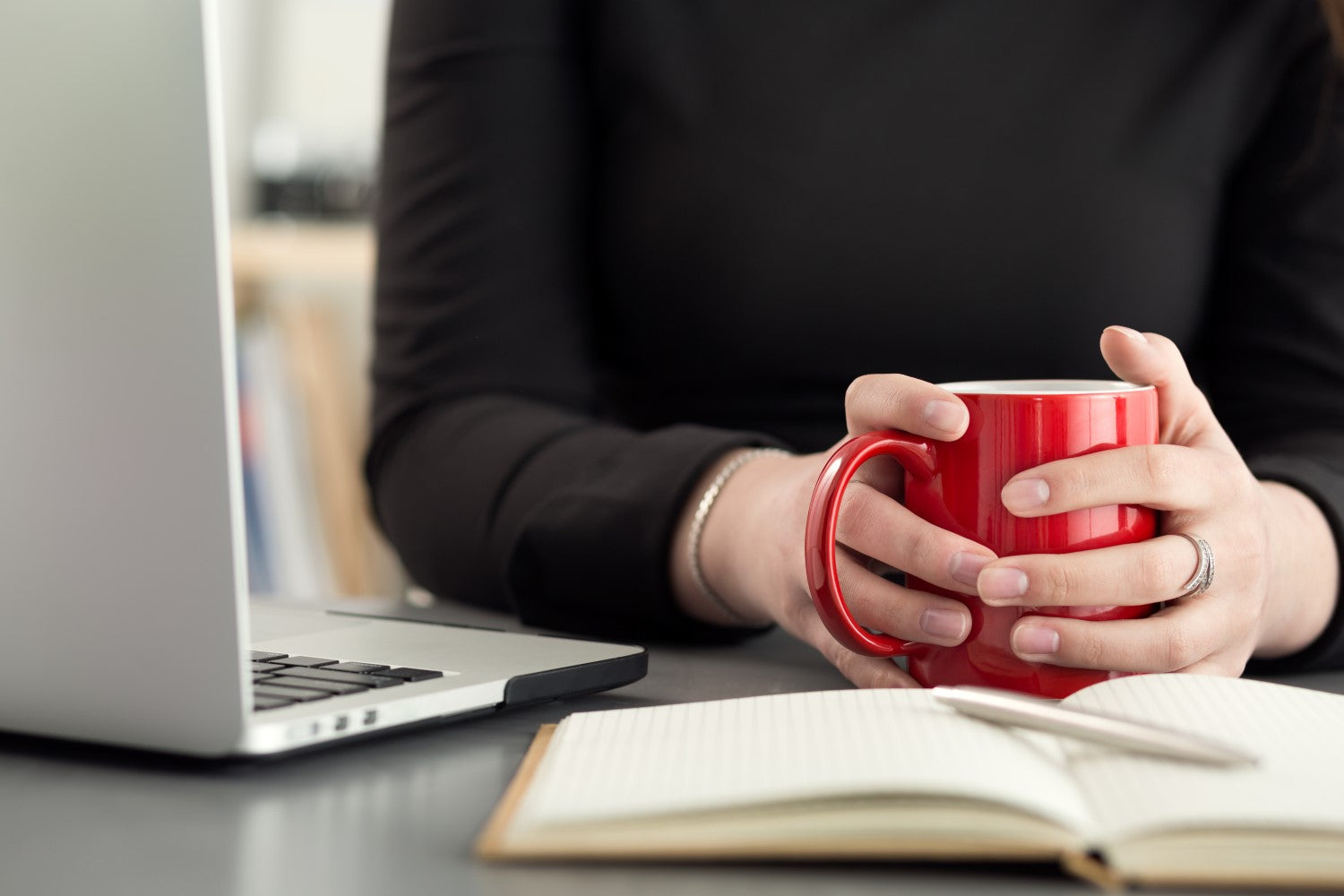 holding red cup with coffee