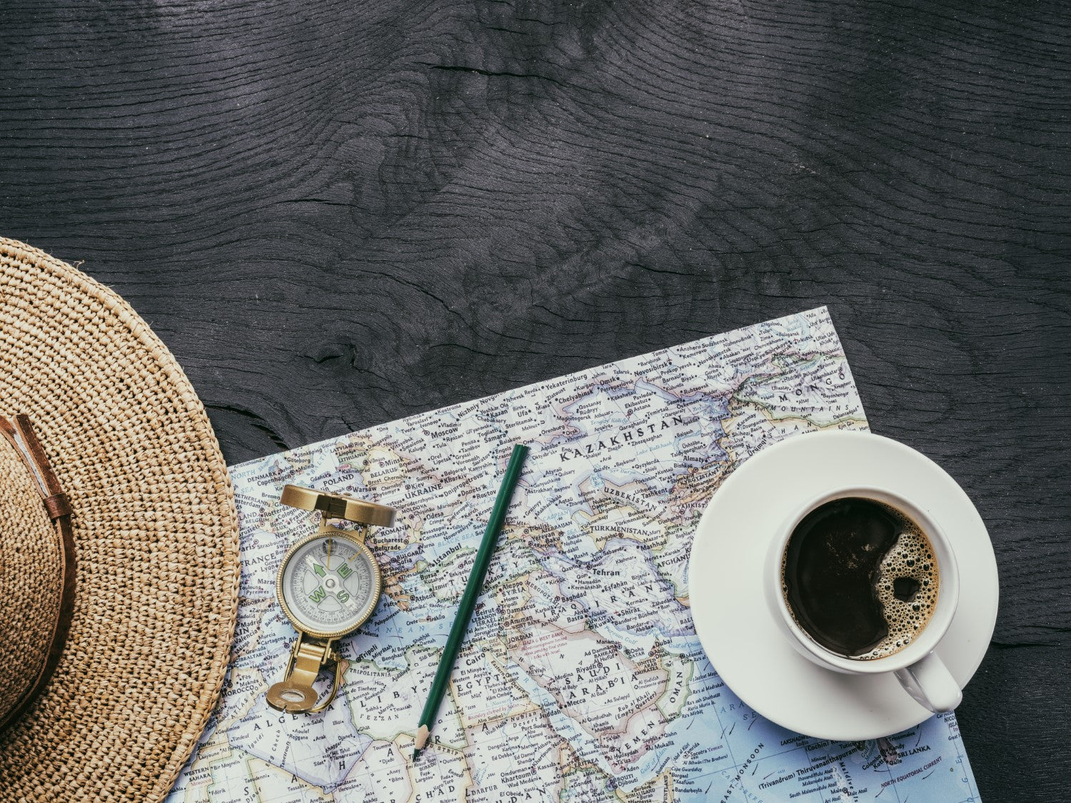 coffee, world map, hat and compass