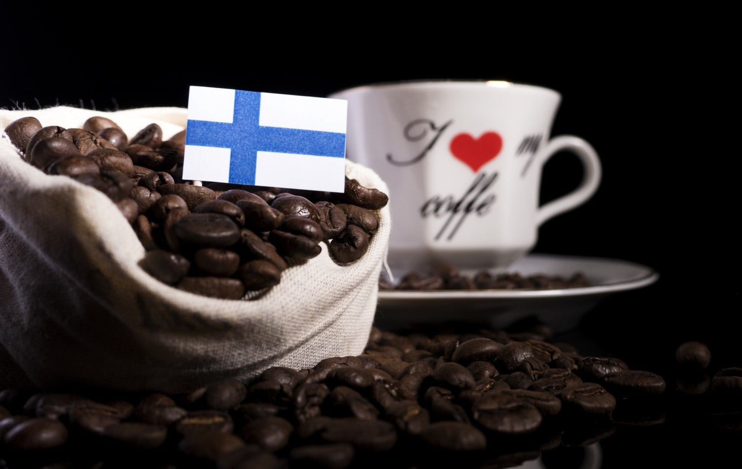 cup of coffee, coffee beans and finland flag