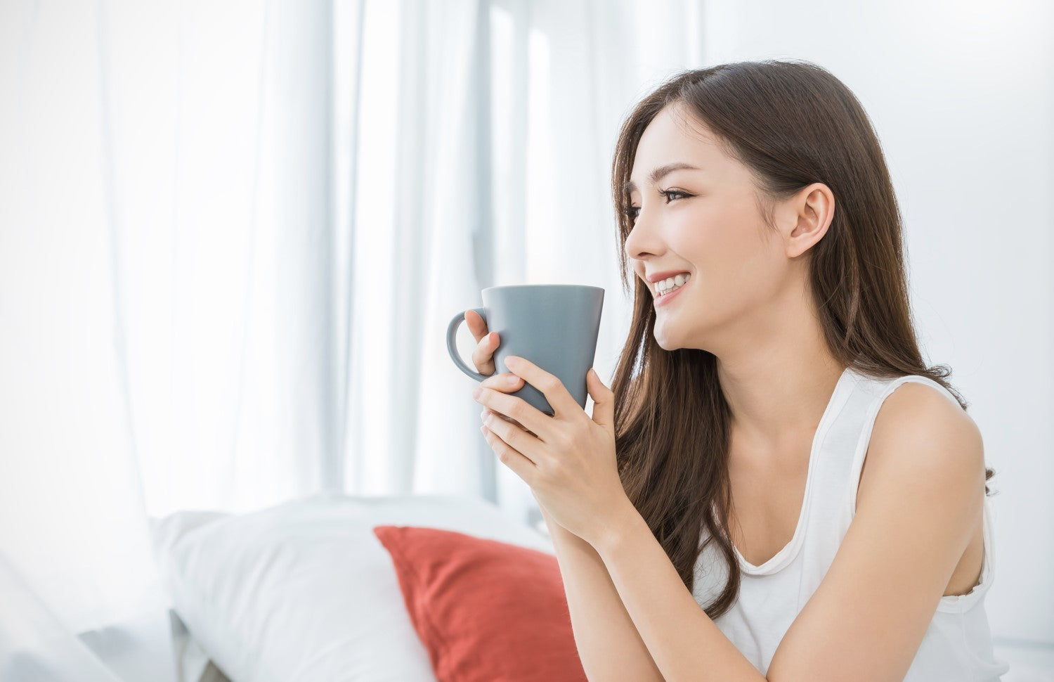 lady in a good mood holding coffee