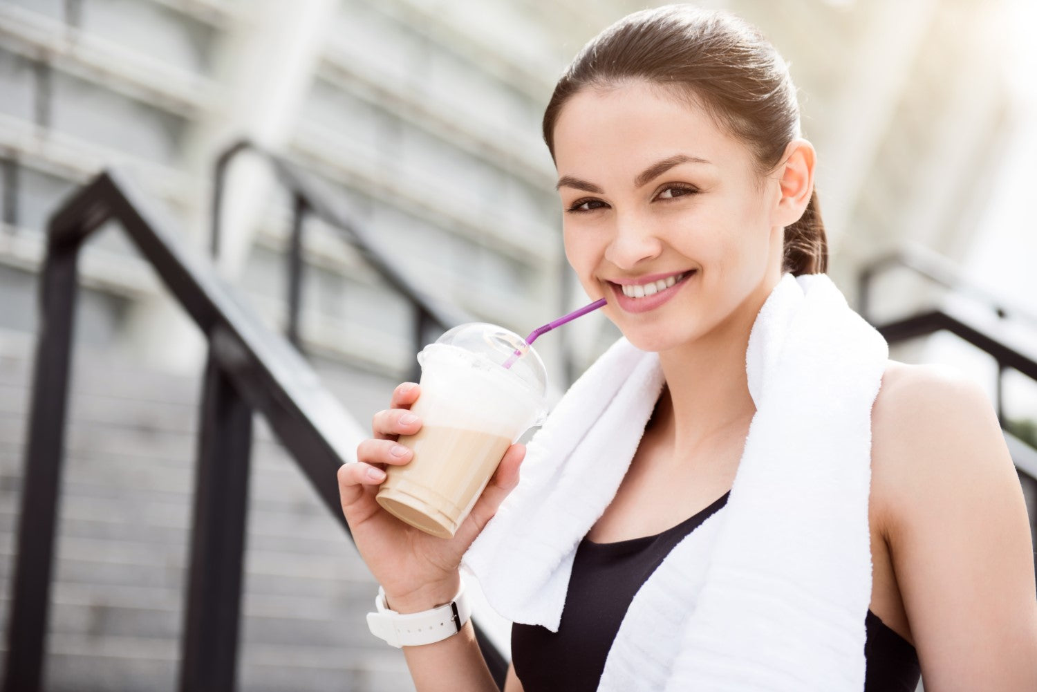 lady with workout outfit drinking coffee