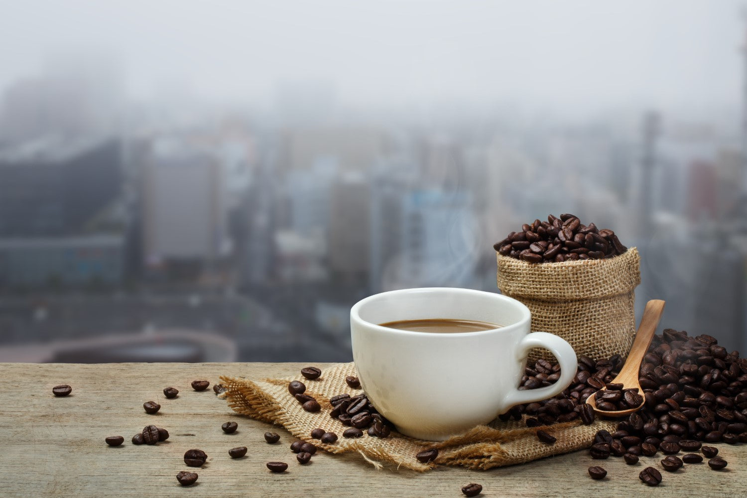 cup of coffee with coffe beans