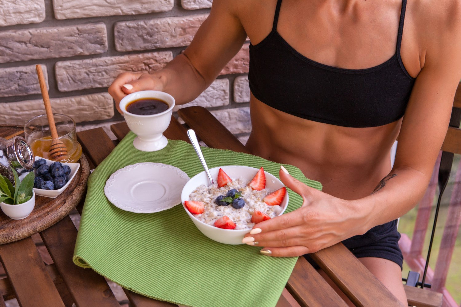 lady with fit body eating healthy diet with coffee