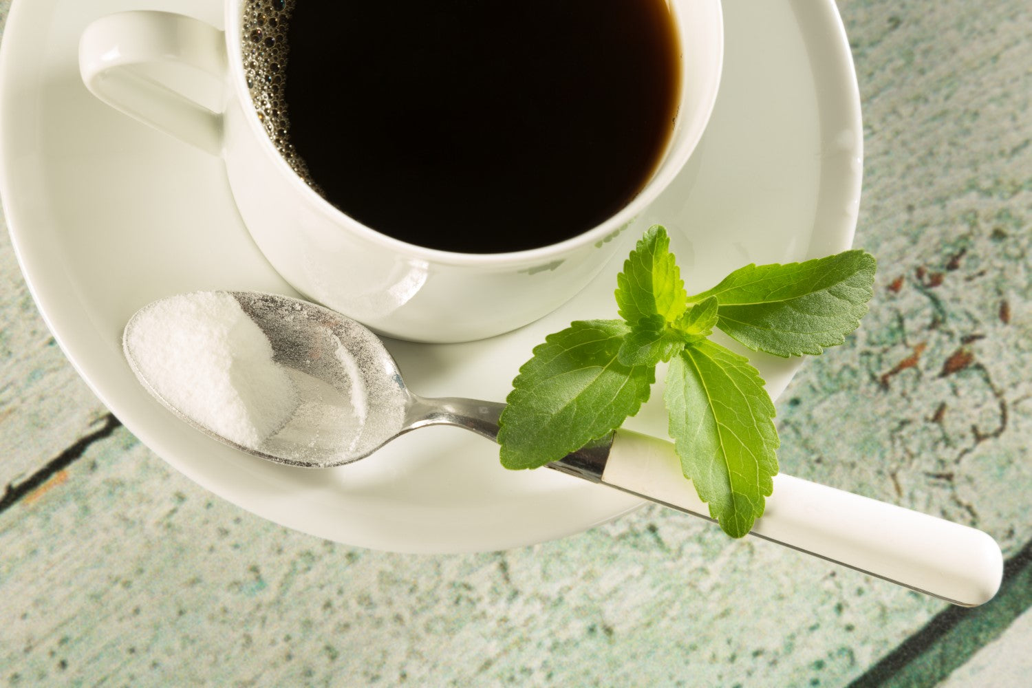 black coffee with leaf