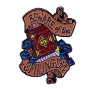 Beware of the Smiling Dungeon Master! enamel pin Mythroll Armory