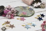 Pearlescent star hairclips