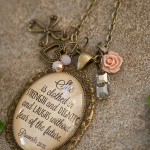She is clothed in strength and dignity and laughs without fear of the future necklace   (Proverbs 31:26)  (charms and beads included)
