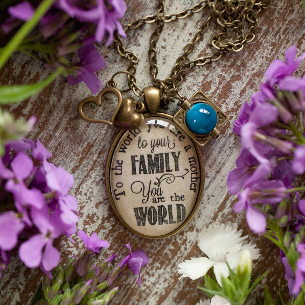 To the world you are a mother, to your family you are the World necklace (charms and beads included)
