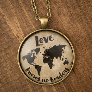 """Love knows no borders"" world map necklace"