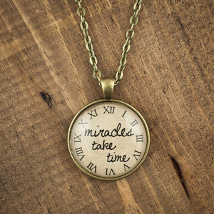 """miracles take time"" necklace"