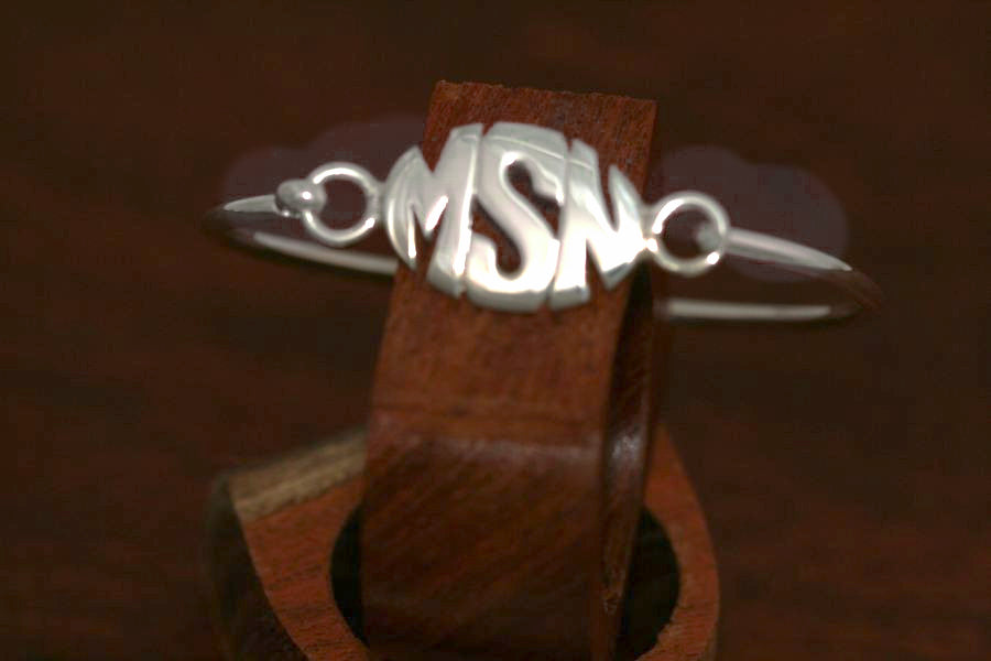 Monogram Oval Disc on a Bangle Bracelet