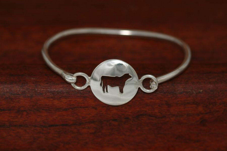 Small Steer Disc-Charm on a Bangle Bracelet