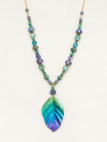 Green, blue, purple gradient elm leaf necklace on a gold chain with beads going up about half-way in various shades of green, blue, and purple.