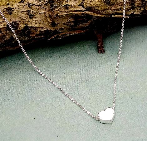 small sterling silver heart with a rolo style chain running through it.