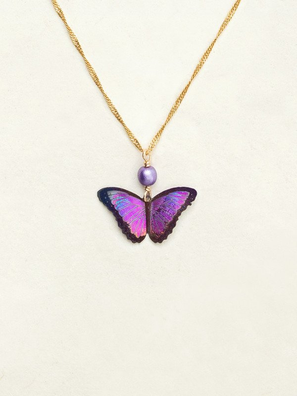 Bright Purple butterfly pendant with black outline on a gold chain with a shiny purple bead.