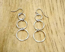 Load image into Gallery viewer, Silver earring with 3 circles dangling in a line. 2 inches long. Light and casual. Made in USA
