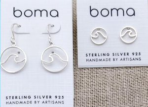 a pair each of drop and stud earrings with wire wave outlines in a circle