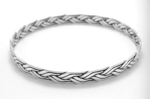 Silver bangle with woven braid design