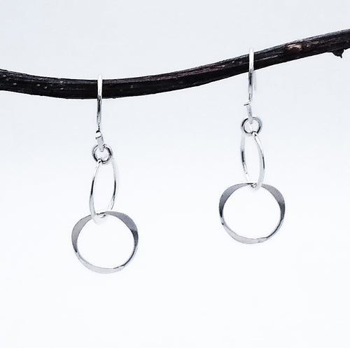 Silver dangle earrings. 2 connected circles hanging.1.25 inches long.
