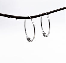 Load image into Gallery viewer, silver hoops with beads. 1.25 inches in diameter.