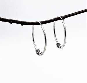 silver hoops with beads. 1.25 inches in diameter.