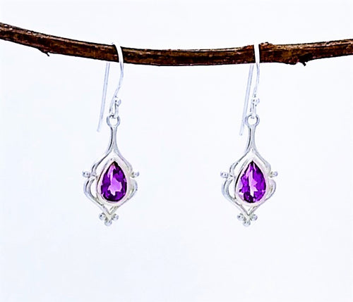 teardrop shaped amethyst with elegant decorative silver setting on a french wire.