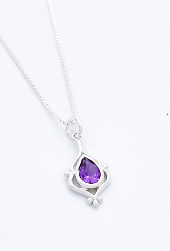 Teardrop shaped amethyst set in an elegant sterling pendant