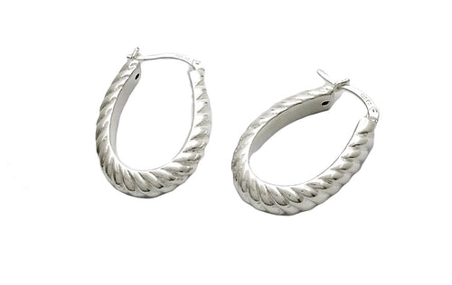 wide oval shaped sterling hoops with braid-like texturing and a snap top closure