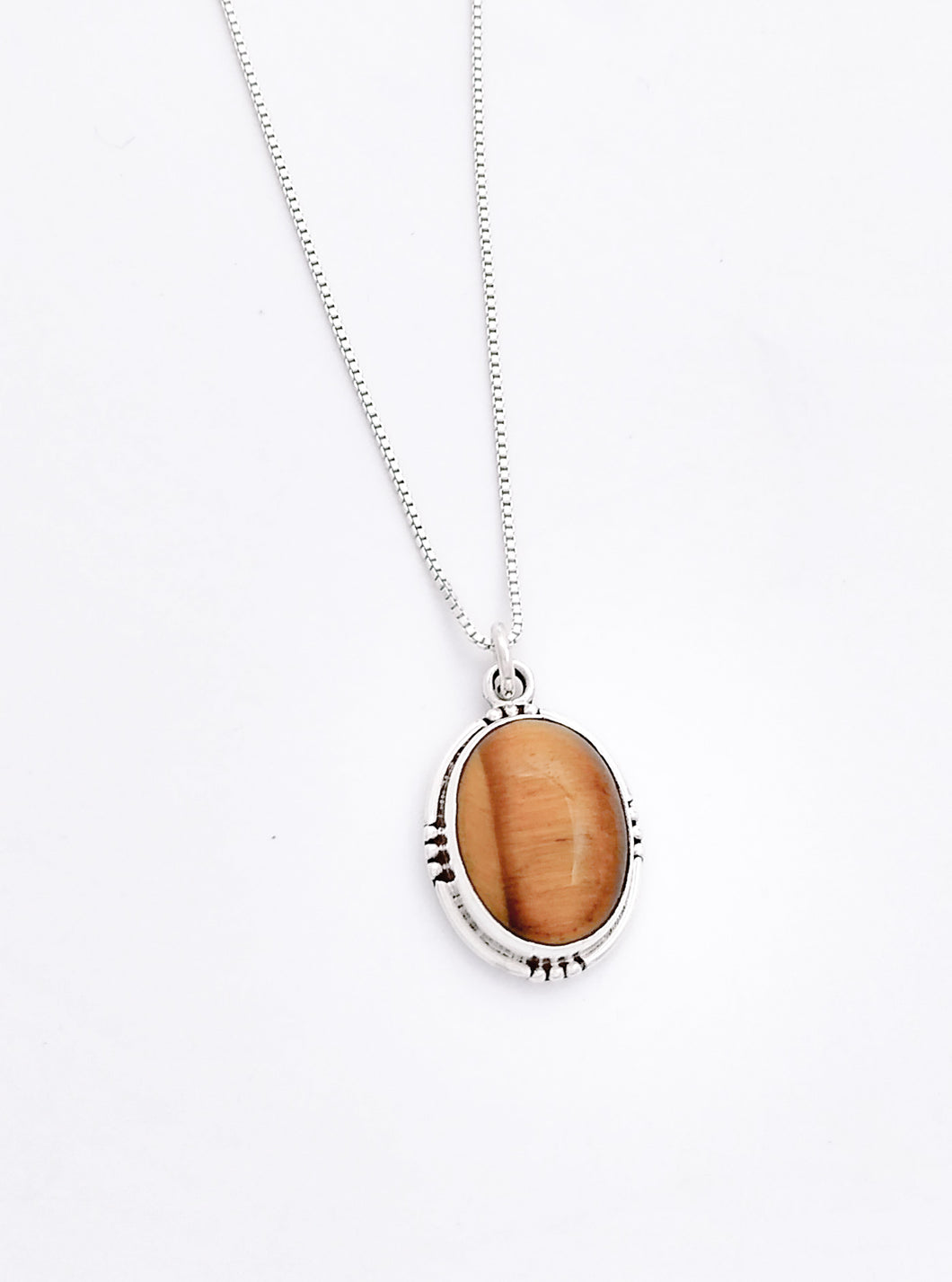 Large Oval Tiger Eye Stone set in sterling silver with 3 small balls set in on 4 sides.