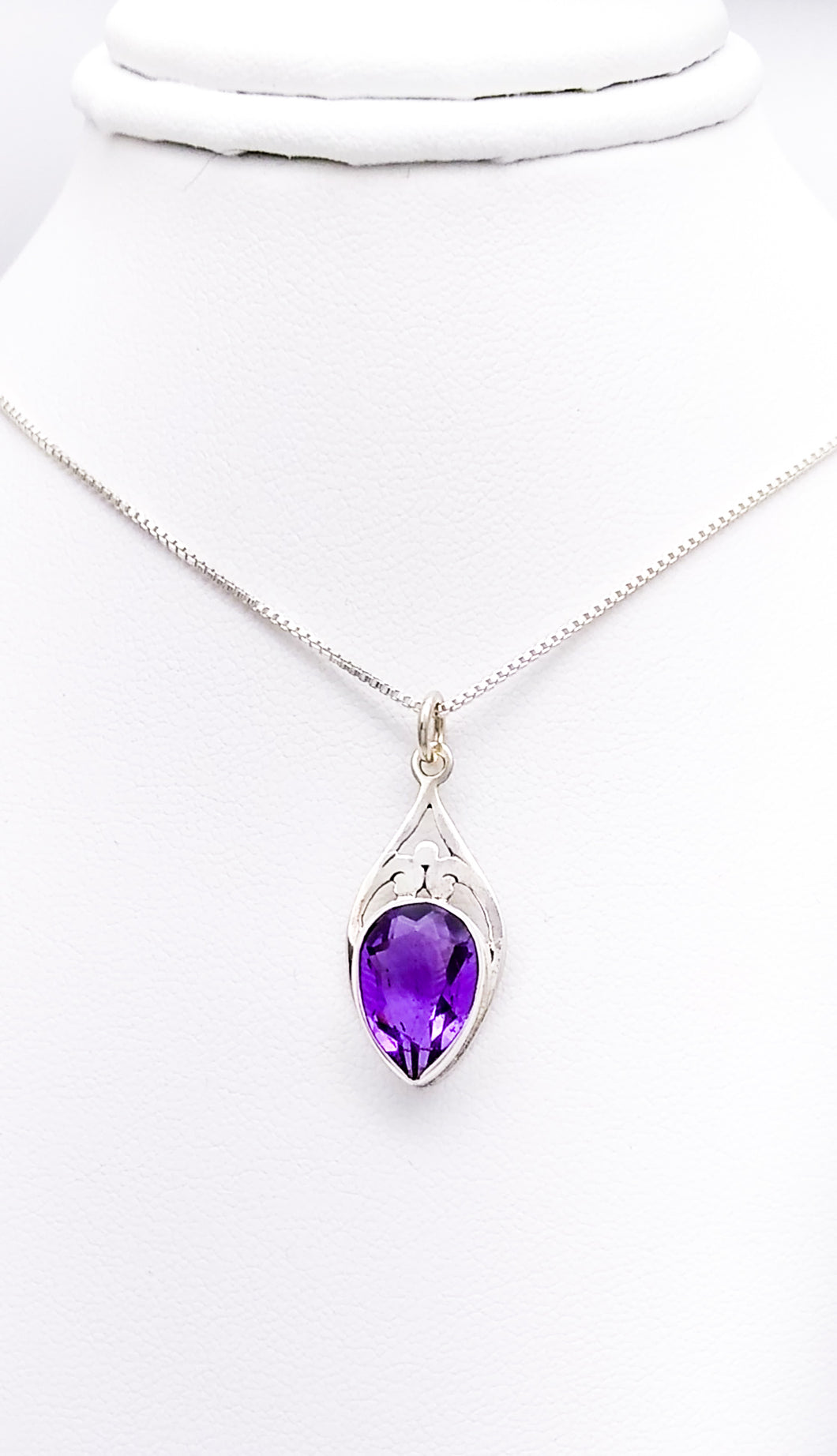 Sterling diamond-shaped pendant with a faceted amethyst in an upside-down teardrop shape.