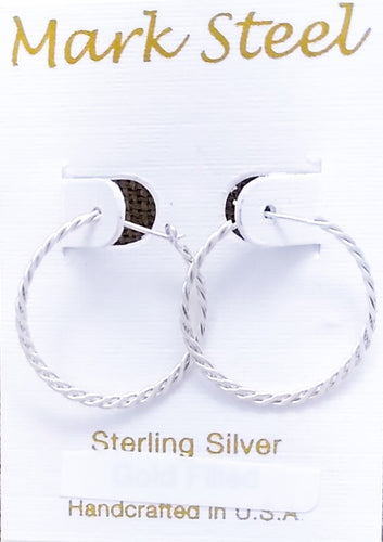 Sterling silver hoops of two woven strands meet in a peg-in-hole style closure.