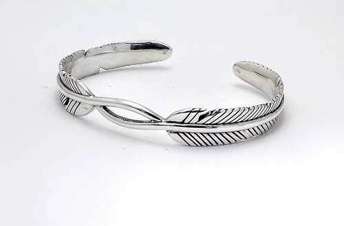 silver cuff bracelet with feather design